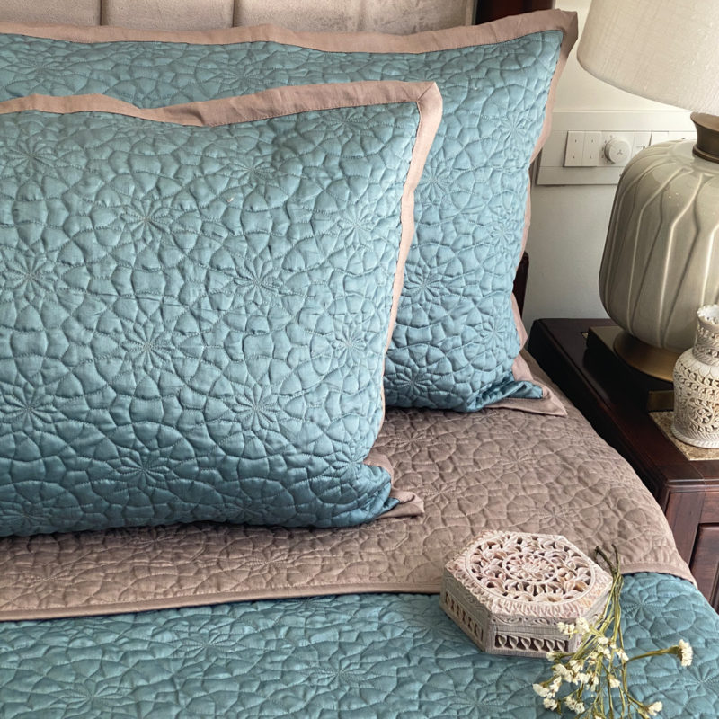 Teal and taupe bedspread